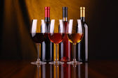 Wine glasses and bottles — Stock Photo