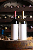 Red and white wine in cellar — Stock Photo
