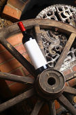 Red wine on wooden wheel — Stock Photo