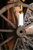 White wine on wooden wheel — Stock Photo