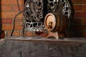 Glass of brandy near a fireplace — Foto de Stock