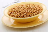 Delicious and healthy honey nuts cereal — Stock Photo