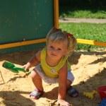 Cute little girl having fun on a playground — Stock Photo