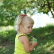 Blond little girl drinking juice with straw — Stock Photo #30147621
