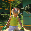 Stock Photo: Cute little girl having fun on a playground