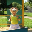 Cute little girl having fun on a playground — Stock Photo #30147631