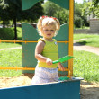 Cute little girl having fun on a playground — Stock Photo
