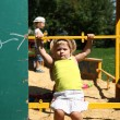 Cute little girl having fun on a playground — Stock Photo #30147687