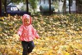 Little girl in autumn park — Stock Photo
