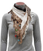 Beige fringe scarf with decoration — Stock Photo