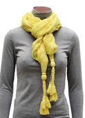 Yellow scarf with fringe ties — Stock Photo