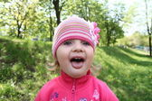 Little girl shows tongue — Stock Photo