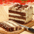 Stock Photo: Slicing tiramisu