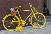 Yellow book bicycle — Stock Photo