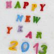 Colorful character made from resin  Happy New Year put word - Foto Stock