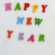 Foto Stock: Colorful character made from resin Happy New Year put word