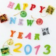 Resin  Happy New Year put word  and Gift - Stock Photo