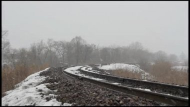 Passenger train on the railway in the winter woods. — Stock Video