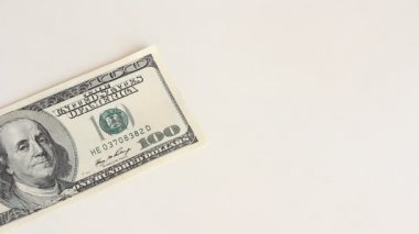 One hundred dollar bills are flying on a white background — Stock Video #12864578