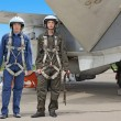 Two military pilot in a helmet near the aircraft — Stock Photo #14031262