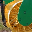 Stock Photo: Disc harrow behind tractor turning soil