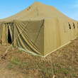 Stock Photo: Very big military tent in field