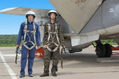 Two military pilot in a helmet near the aircraft — ストック写真