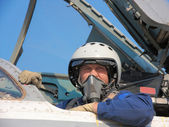 Military pilot in a helmet on a aircraft — Stock Photo