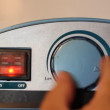 Water temperature controls on a hot water heater, twist hand. - Foto Stock