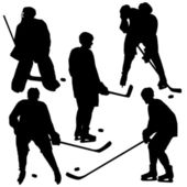 Set of silhouettes of hockey player. Vector illustrations. — Stock Photo