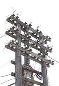 Old decrepit wooden telephone pole — Stock Photo