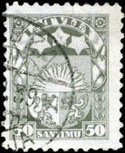 LATVIA - CIRCA 1923: A stamp printed in Latvia shows Latvian Coa — Stock Photo