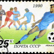 USSR - CIRCA 1990: a stamp printed by USSR shows football player — Stock Photo
