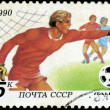 USSR - CIRCA 1990: a stamp printed by USSR shows football player — ストック写真