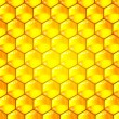 Golden  cells of a honeycomb pattern. Vector illustration. - Stock Photo