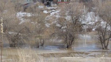 Spring snow melting on the river, in April — Stockvideo