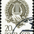 RUSSIA - CIRCA 1998: A stamp printed in Russia shows Harp inside — ストック写真