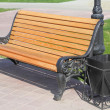 Stock Photo: Wooden bench with urn