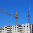 Construction site with two cranes against the sky — Stock Photo