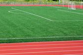 Soccer green field artificial grass with white lines — Stock Photo