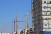 Construction site with many cranes against the sky — Stock Photo