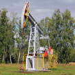 Stock Photo: Oil pumpjack. Oil industry equipment.