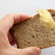 Butter being spread on a  toast slice. — Stock Video