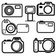 A set of digital cameras — Stock Vector #34536473