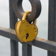 Ritual of affixing padlocks, as symbol of love — Stock Photo
