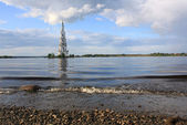 Belltower on the river — Stock Photo