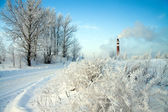 Smoking chimney in winter — Stock Photo