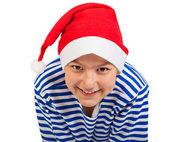 Boy teenager with Santa hat — Stock Photo