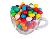 Colorful candies in a glass isolated — Stockfoto