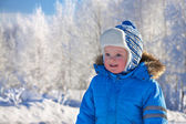 Small child the boy on walk in the winter in park — Stock Photo